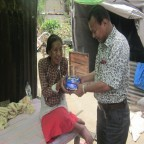 rajendra-nhisutu-is-helping-to-the-senior-leg-swollen-earthquake-survivor-144x144
