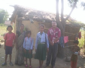 rajendra-with-children-in-nepal-village