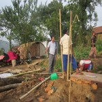 Rajendra-and-HIMET-team-with-zinc-slates-tent-making-in-Nepal